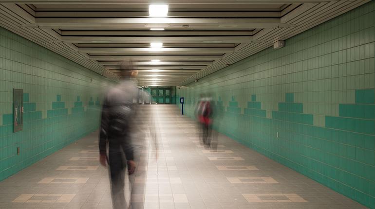 Commuters walking along an underground pedestrian passage